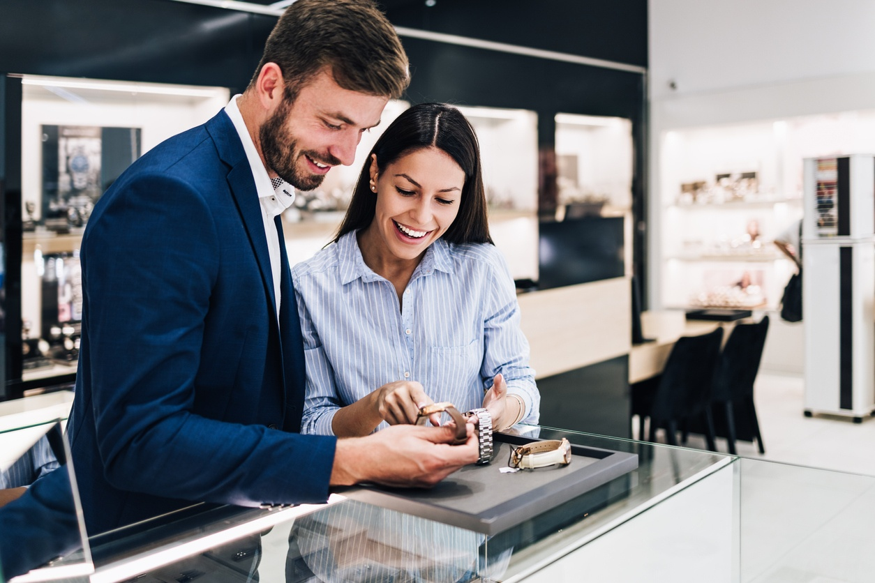 Middle age couple in jewelry store