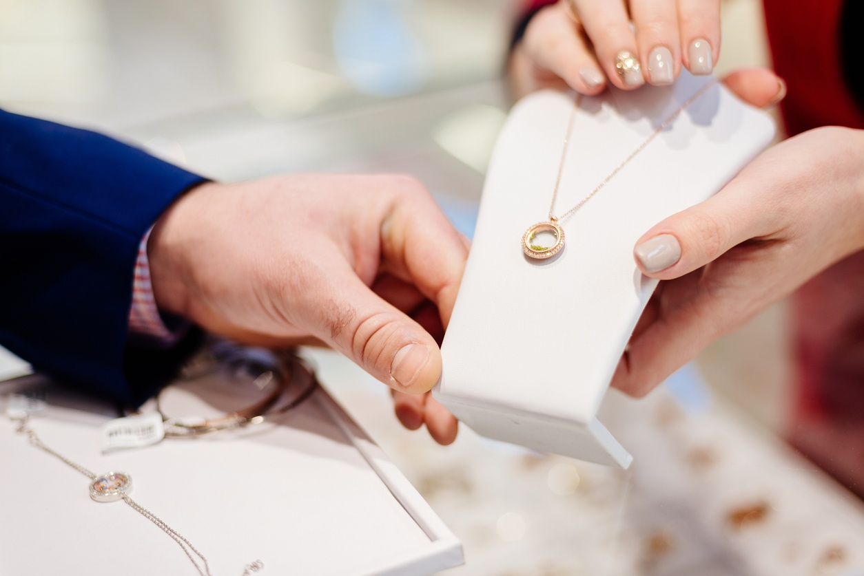 Man buying necklace in jewelry store